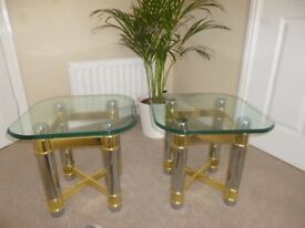 Set of 2 glass top tables.