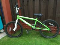 """Boys 20"""" bike bmx green with stunt pegs can deliver for a small charge"""