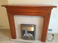 Fire surround, marble back and electric fire