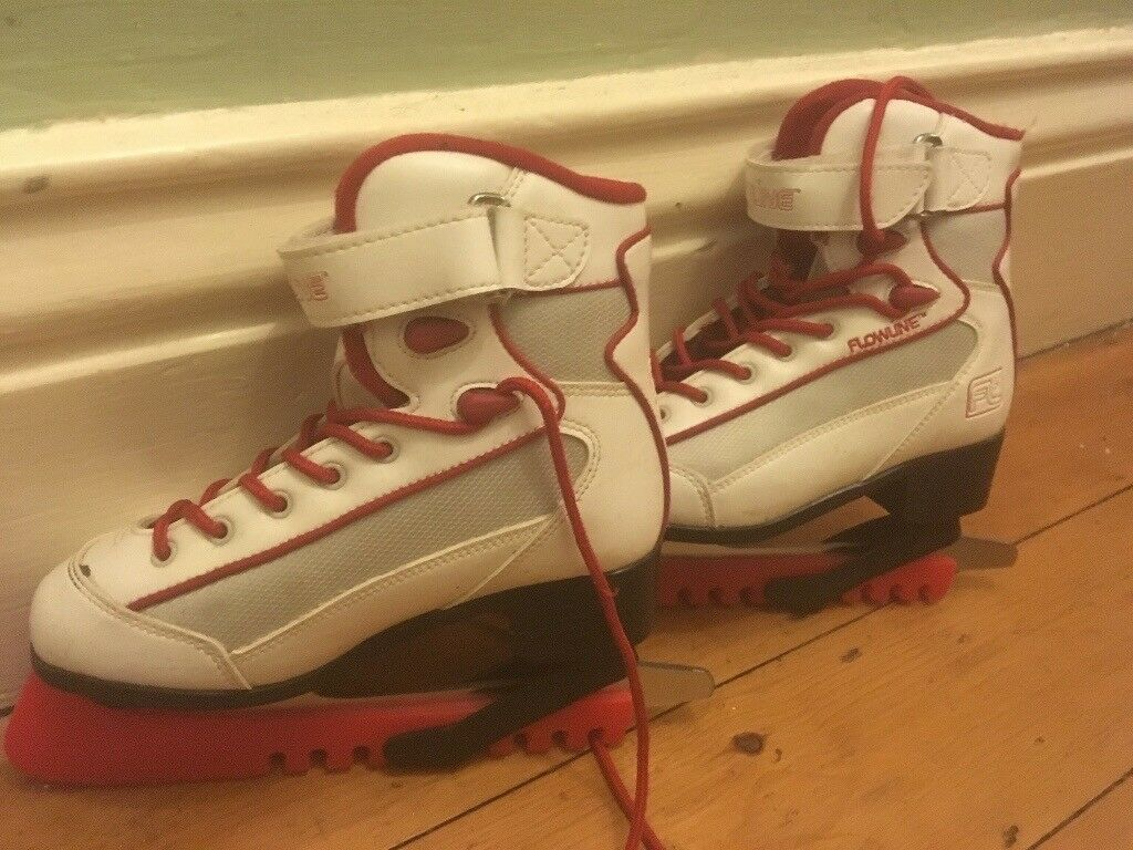 Girls Flowline white ice skating boots with blade covers size 1