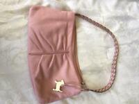 Tula leather bag with Radley dog tag