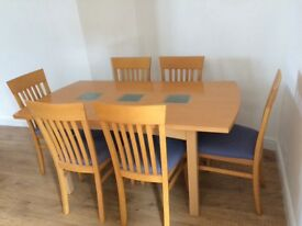 Contemporary wood dining table and six chairs