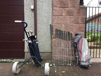 2 sets of golf clubs and a golf trolley