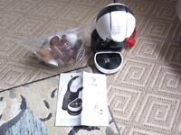 Delonghi Dolce Gusto with bag of capsules
