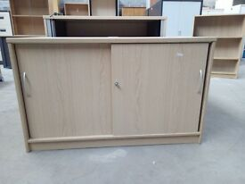 1200x725x600mm Low oak cupboard with two sliding doors, 1 shelf and keys. £75
