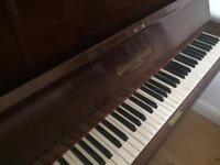 Mahogany upright piano and duet stool