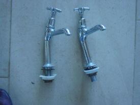 pair of chrome bath taps