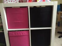 IKEA square storage unit with 4 canvas storage boxes
