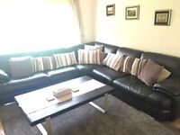 Large leather corner sofa with large foot stool