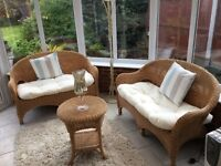 Two 2 Seater conservatory furniture set, complete with round wicker table.
