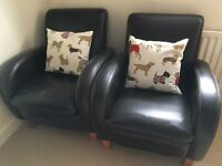 Pair of brown leather retro style armchairs