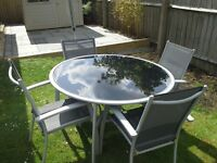 Round Black Glass top garden table and 4 chairs.