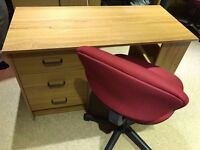 Wooden-coloured free-standing desk with 3 drawers and 3 shelves - good condition.
