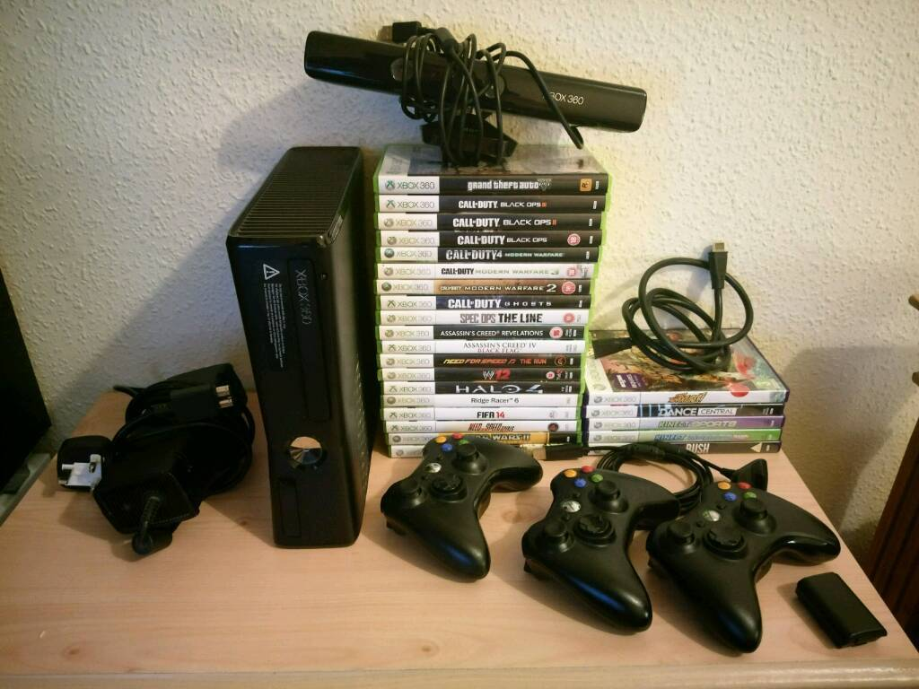 Xbox 360 250gb console with Kinect and 25 games plus 3 controllers.