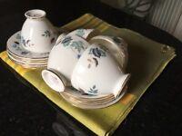 Tea set and 2 tea cups plus table cloth