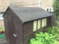 FREE 6x8 ft. SHED, a bit old but still sturdy. Collector to dismantle and transport away ASAP.