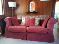 Sofa bed with loose covers in terracotta, spare set of covers included