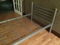 Single metal frame bed with mattress