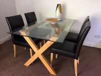 Beautiful dinning table and 4 leather chairs