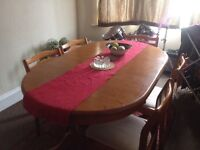 Pine 6 or 8 seater extendable dining table, 6 chairs included