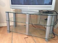 Large heavy duty glass tv table. Reinforced glass for heavy tv .Great looking piece . A bargain !!!
