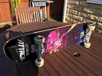 Skateboard with Space Invaders design