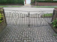 2 pairs of black metal gates