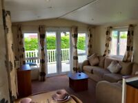 luxury static caravan holiday home for sale with full wrap around upvc decking nr mablethorpe, lincs