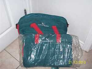 2 cathy pacific duffle bags,new with tags. 1 in plastic remainin