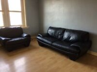 Black leather sofa and single chair good condition