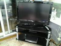 32 inch LG hd lcd television with black glass 3 shelf stand