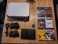 Playstation 2, slim, with games and case