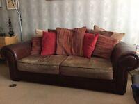 Leather cushion back sofa