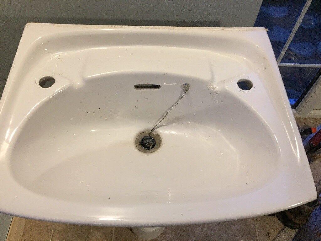 White bathroom sink with full pedestal