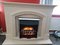 Electric Fire & Stone effect surround.