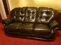 Black leather settee and armchairs