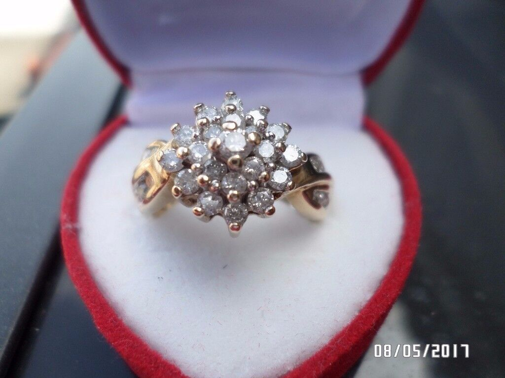 LADIES LOVELY 9 CT YELLOW GOLD 1/2 CT DIAMOND RING.