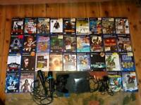 Playstation 2 with singstar mikes and 31 games