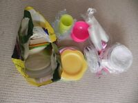 Large bag of plastic and paper plates, plastic cups and plastic cutlery