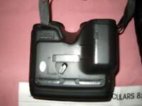 Minolta Autofocus 10 x 25 binoculars in very good condition + leather case and user manual