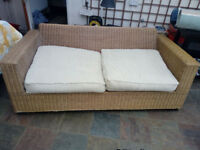 Lovely solid wicker sofa bed - very comfortable sleeps two in very good condition