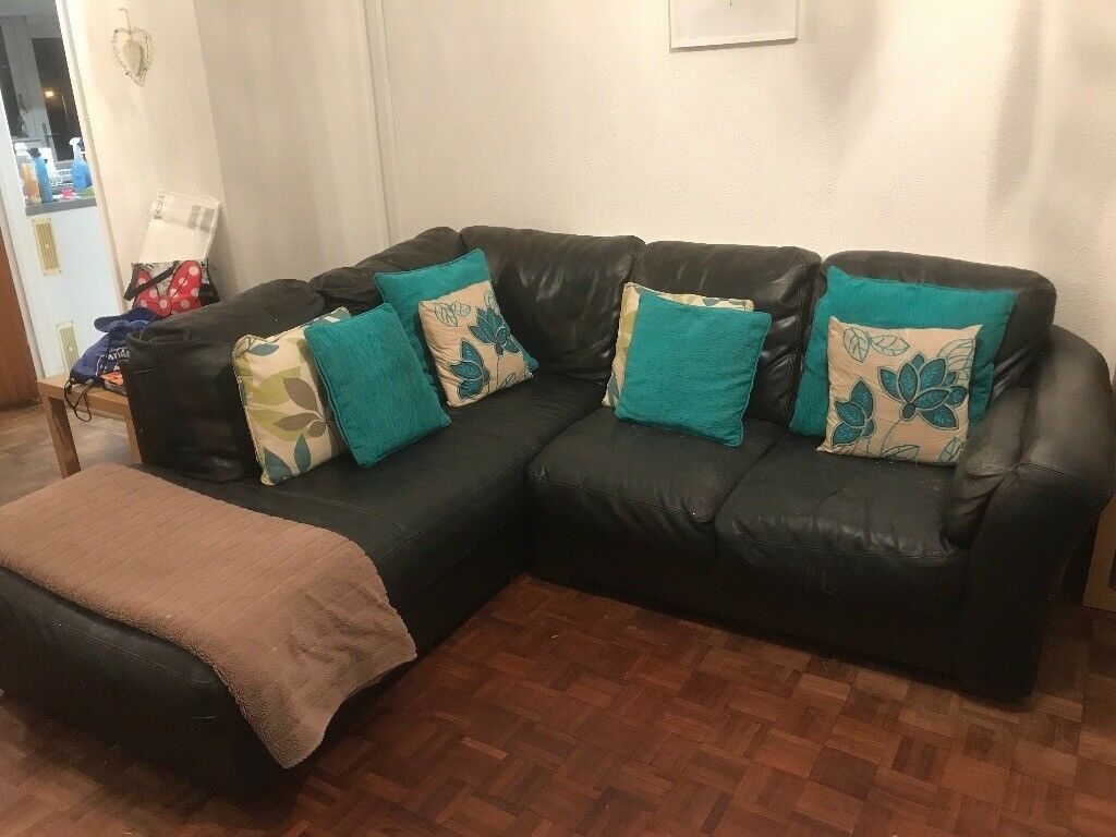 Large brown corner sofa. SmallTear in one seat and in need of. Good clean and ploish