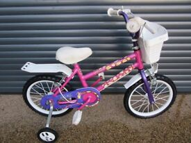 GIRLS FIRST BIKE IN VERY GOOD USED CONDITION WITH STABILISERS. (SUIT APPROX. AGE.3 / 4+)..