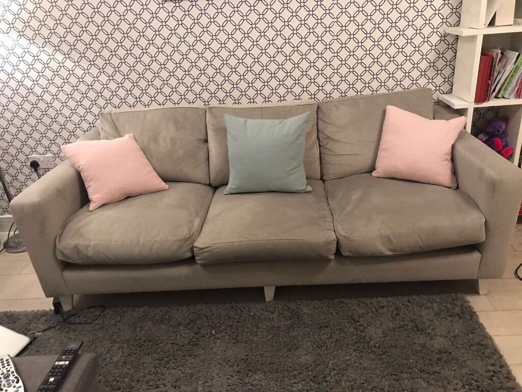£200 for 2 grey sofas, 3 + 2 seat, good condition.