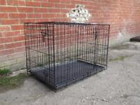 Dog crate excellent condition depth 56cm width 92cm height 52cm