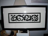 Oriental style design wall art mounted in a black frame