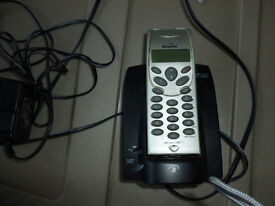 Silver cordless phone in good condition