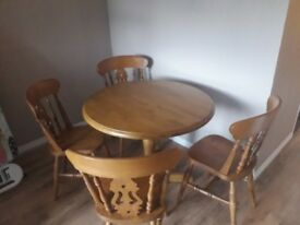 Extending circular table and 4 chairs