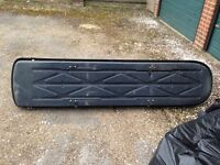 Large Thule roof box with key. At least 6 ft long, come with brackets but will need a roof rack
