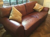 Marks and Spencer's large leather settee in tan colour.